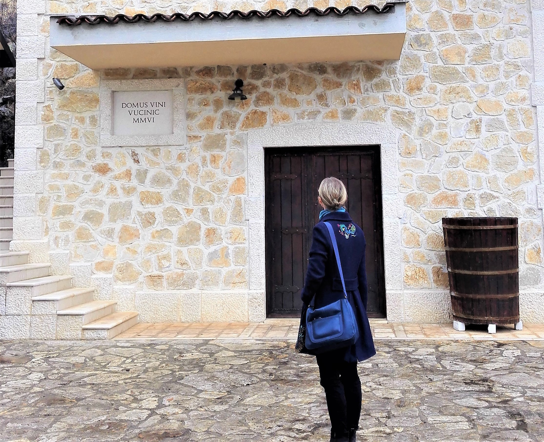 In Front of the Cellars in Zenta Winery; photo by Bernadette